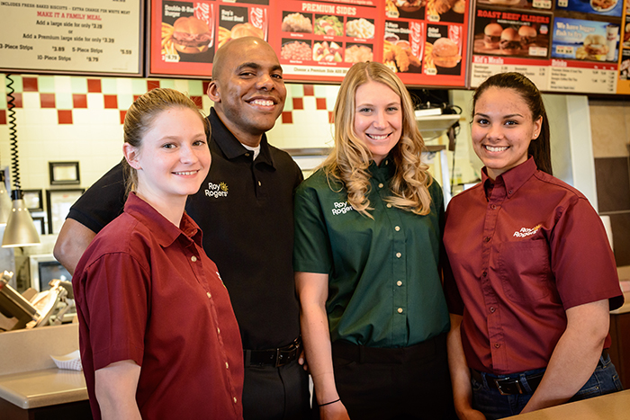 Roy Rogers team members with manager